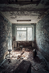 Chilling tour in the haunting remains of the Chernobyl site 30 years on ..When 29 years ago a mile-tall blue flame shot high into the sky, burning a hole in the ozone layer, the eyes of the world focused on the human-made volcano - Soviet Reactor 4 of the Chernobyl Nuclear Plant - spewing 400 times more radioactive load than the bomb dropped on Hiroshima. .It was the Cold War, so American satellites were zooming in on the plant, now with a glowing red spot, much like a fresh gunshot wound on Earth's surface, bleeding plutonium..'We did not know that death could be so beautiful,' said those who saw it from the model Soviet town of Pripyat, built specially for the employees of the plant, clean and church-less. ..Ukraine is holding commemorations to mark the 30th anniversary of the nuclear disaster in Chernobyl..Sirens were sounded at the same moment as the first explosion at the reactor, in the early hours of 26 April 1986..The meltdown at the plant remains the worst nuclear disaster in history..An uncontrolled reaction blew the roof off, spewing out a cloud of radioactive material which drifted across Ukraine's borders, into Russia, Belarus and across a swathe of northern Europe..©Michal Huniewich/Exclusivepix Media (Credit Image: © Exclusivepix media via ZUMA Press)