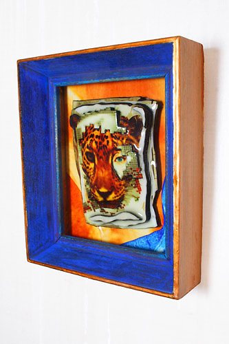 """title: """"Little Leopard""""<br /> <br /> dimensions: 5""""x4""""x2""""<br /> <br /> materials: montage, alchemic photography & mixed media encased in glass frame<br /> <br /> +created & designed photo sculpture by Star Nigro exclusively<br /> <br /> www.StarNigro.com"""