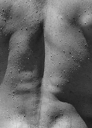 detail of a man's back after a shower