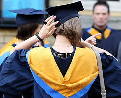File photo dated 12/10/11 of graduates. Nearly half of students would describe themselves as customers of their university, new research suggests.
