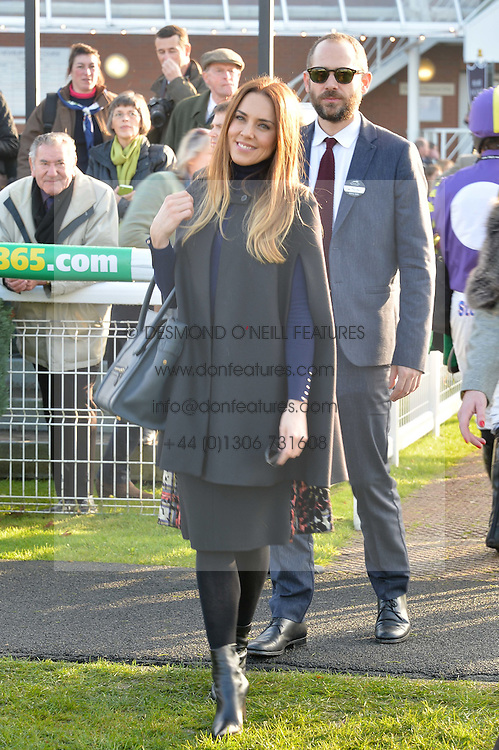 Singer MEL C and JOE MARSHALL at the 2014 Hennessy Gold Cup at Newbury Racecourse, Newbury, Berkshire on 29th November 2014.  The Gold Cup was won by Many Clouds ridden by Leighton Aspell.