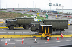 © Licensed to London News Pictures 26/12/2020.        Dover, UK. Army vehicles at the Port of Dover. Over 1000 lorries are left queuing on the M20 heading for Dover as Manston Airport is cleared. Emergency services and military personnel continue to tests travellers at Dover in Kent for Coronavirus before they cross the English Channel. Photo credit:Grant Falvey/LNP