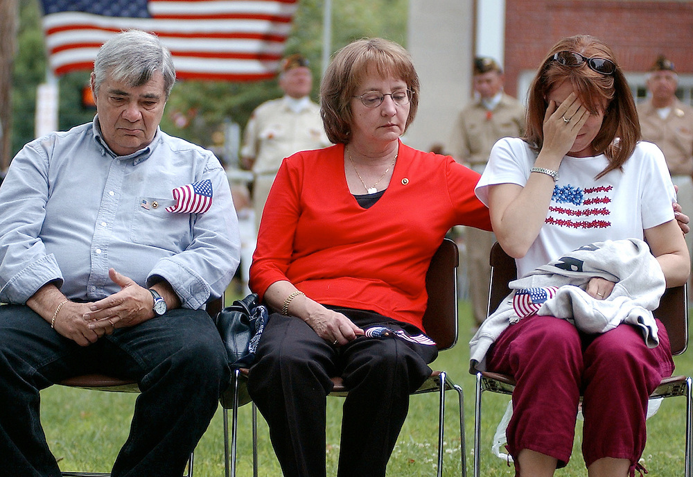 Claire Del Greco consoles daughter Alexa with father Felix Sr. beside her during Memorial Day ceremonies in SImsbury, Conn.  Del Greco's son, Sgt. Felix Del Greco, Jr., 22, became the first Connecticut National Guardsman to die in combat when he was killed in an ambush while on patrol in Baghdad. The Del Greco's were honored with a Citizen of Year award in their son's memory.