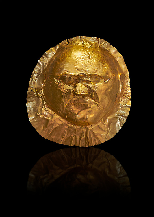 Mycenaean gold death mask, Grave Cicle A, Mycenae, Greece. National Archaeological Museum of Athens.  Black Background<br /> <br /> This death mask is typical of the other Mycenaean gold death masks fround in Grave V except in this mask the eyes are open. made from a sigle sheet of gold the shape of the face would have been hammered ot against wood. two holes either side of the gold mask allowed it to be held over the dead mans face. As weapons were found in the graves of Grave Circle A at Mycenae, those buried here wer warriors and maybe kings as the grave goods buried with them were of great value. 16th century BC .<br /> <br /> If you prefer to buy from our ALAMY PHOTO LIBRARY  Collection visit : https://www.alamy.com/portfolio/paul-williams-funkystock/mycenaean-art-artefacts.html . Type -   Athens    - into the LOWER SEARCH WITHIN GALLERY box. Refine search by adding background colour, place, museum etc<br /> <br /> Visit our MYCENAEN ART PHOTO COLLECTIONS for more photos to download  as wall art prints https://funkystock.photoshelter.com/gallery-collection/Pictures-Images-of-Ancient-Mycenaean-Art-Artefacts-Archaeology-Sites/C0000xRC5WLQcbhQ