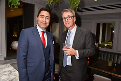 Left to right, Soloman Khaddour and Hugh Seaborn at a party to celebrate the launch of Hans' Bar & Grill, 11 Cadogan Gardens, Chelsea, London, England. 07 June 2018.