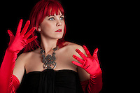 Portrait of young redhair caucasian woman with red gloves.