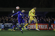 AFC Wimbledon midfielder Dannie Bulman (4) and Sutton United Maxime Biamou (24) during the The FA Cup third round replay match between AFC Wimbledon and Sutton United at the Cherry Red Records Stadium, Kingston, England on 17 January 2017. Photo by Stuart Butcher.