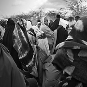 A group of refugees gather to meet the officials for registration outside a registration and food distribution point in IFO camp in Dadaab Refugee camp in northeastern Kenya. Hundreds of thousands of refugees are fleeing lands in Somalia due to severe drought and arriving in what has become the world's largest refugee camp. Photo: Sanjit Das/Panos