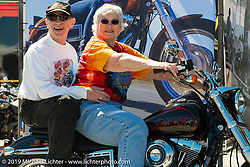 Karl and Mel Kegel, owners of Kegel Harley-Davidson in Rockford, IL, the oldest family owned HD Dealership in the world, try out the just introduced Lowrider model at the Harley-Davidson display during Daytona Bike Week, FL., USA. March 8, 2014.  Photography ©2014 Michael Lichter.