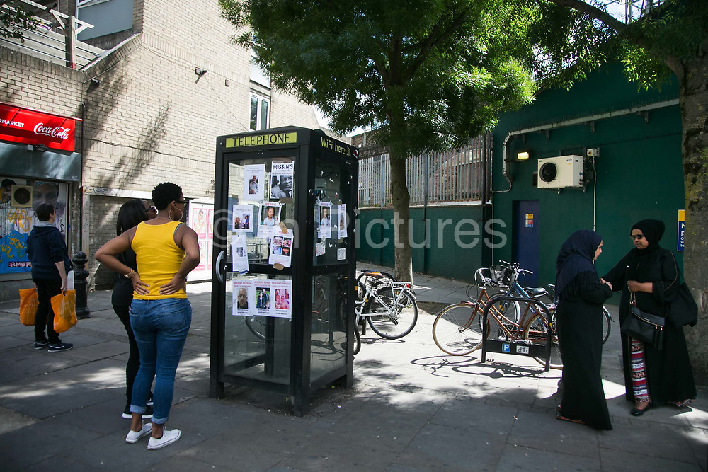Locals discuss recent evenst and look at missing posters  June 16th 2017, London, United Kingdom. Grenfell Tower burned out after a catastophic fire killing more than 58 people. The tower caught fire early Wednesday morning and final casualty figueres may end up to be many more with police not expecting to be able to find and recover all bodies and to find all missing people. No fire sprinkler in place and cheap cladding made with plastic is so far blamed for the ferocious fire.