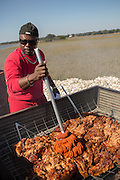 BBQ Pit Master Rodney Scott during Cook it Raw outdoor BBQ event on Bowen's Island October 26, 2013 in Charleston, SC.
