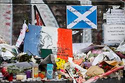 © Licensed to London News Pictures. 17/11/2015. Paris, France. Flowers left at a memorial at Place de la Republique in Paris, France following the Paris terror attacks on Tuesday, 17 November 2015. Photo credit: Tolga Akmen/LNP