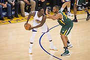 Golden State Warriors forward Draymond Green (23) looks for an open teammate against the Utah Jazz at Oracle Arena in Oakland, Calif., on December 20, 2016. (Stan Olszewski/Special to S.F. Examiner)