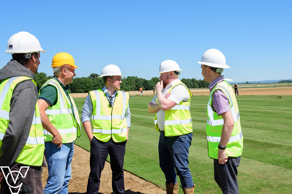 Work has been progressing on Lincoln City's new training ground in Scampton, near Lincoln.  Pictured from left, John Guest (Njord Design & Build project manager), Darren Curtis (Lincoln City operations manager/safety officer), Oliver Fytche-Taylor (West Lindsey District Council's head of planning), Steve Jones (Njord Design & Build managing director) and Ian Elliott (West Lindsey District Council's senior development management officer).<br /> <br /> Picture: Chris Vaughan Photography for Lincoln City<br /> Date: June 22, 2018