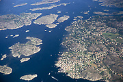 Aerial photo of coastal area with small islands  dotted with detached houses, Scandinavia, 1970 thought to be near Gothenburg
