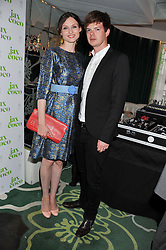 SOPHIE ELLIS-BEXTOR and RICHARD JONES at a party to celebrate the launch of Jax Coco - a new soft drink, held at Harvey Nichols 5th Floor Bar, 109-125 Knightsbridge, London on 25th June 2012.