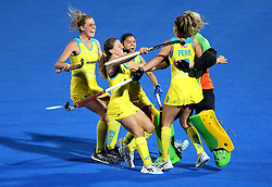 Australia's Brooke Peris celebrates with teammates after scoring the winning goal in sudden death of the shootout