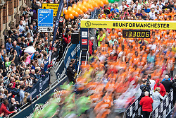 © Licensed to London News Pictures . 28/05/2017 . Manchester , UK . The Great Manchester Run 2017 - runners form up and set off from Portland Street in Manchester City Centre . Security is still heightened in Manchester following a murderous bomb attack at an Ariana Grande gig at Manchester Arena on Monday 22nd May . Photo credit : Joel Goodman/LNP