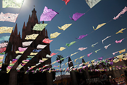 North America, Mexico, San Miguel de Allende, La Parroquia de San Miguel Church and tissue paper flags