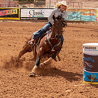 Photo: Jeffery Jones<br /> Paige Magby rides her horse around a barrel Saturday at thr New Mexico High School Rodeo Association State Finals at Red Rock Park.