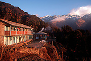 A dawn landscape of a mountain hostel at Ghorepani in the Annapurna Sanctuary, a preservation area of Nepal, high in the Himalayan foothills, on 16th January 1997, in Ghorepani, Nepal. Villages like this partly-depend on the agriculture of rice-growing and also on the passing tourist trade. Western trekkers walk through these tiny communities on their way up the series of climbing trails of the Annapurna Conservation Sanctuary circuit, a sometimes rigorous walk from the low hills of Pokhara to the higher altitudes of Annapurna, the (26,000 feet (8,000 metre) peak. (Photo by Richard Baker / In Pictures via Getty Images)