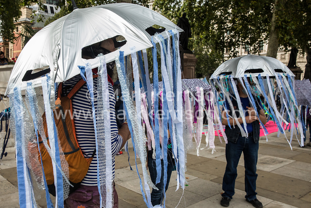 London, UK. 6th September, 2020. Climate activists dressed as jellyfish from the Ocean Rebellion prepare to take part in a colourful Marine Extinction March. The activists, who are attending a series of September Rebellion protests around the UK, are demanding environmental protections for the oceans and calling for an end to global governmental inaction to save the seas.