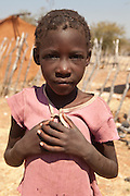 A humble Herero boy poses in his village in Namibia, Africa.