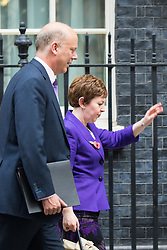Downing Street, London, October 27th 2015.  Leader of the Commons Chris Grayling and Leader of the House of Lords Baroness Stowell leave 10 Downing Street after attending the weekly cabinet meeting, following the previous nights defeat in the Lords of the Tax Credits reforms.