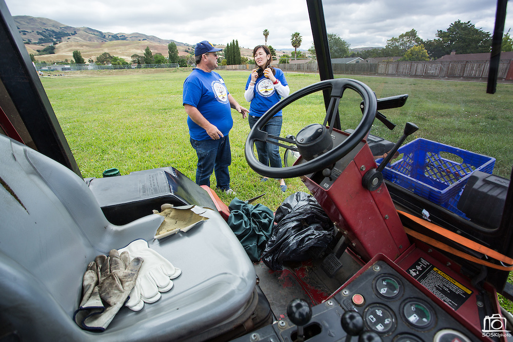 Spangler Elementary School principal Catherine Waslif and MUSD Bus Driver and Grounds Keeper Anthony Gomez talk about the workhorse mower during the California School Employees Association Appreciating Classified Employees event throughout the Milpitas Unified School District in Milpitas, California, on May 21, 2015. (Stan Olszewski/SOSKIphoto)