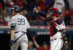 October 5, 2017 - Cleveland, OH, UKR - The New York Yankees' Aaron Judge (99) walks back to the dugout after striking out against Cleveland Indians pitcher Trevor Bauer in the first inning in Game 1 of the American League Division Series on Thursday, Oct. 5, 2017, at Progressive Field in Cleveland. At right is Indians catcher Roberto Perez. (Credit Image: © Leah Klafczynski/TNS via ZUMA Wire)