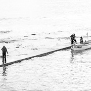 Cornwall. Cornish Fisherman collecting traps. St Ives.<br /> <br /> St Ives (Cornish: Porth Ia, meaning St Ia's cove) is a seaside town, civil parish and port in Cornwall, England, United Kingdom. The town lies north of Penzance and west of Camborne on the coast of the Celtic Sea. In former times it was commercially dependent on fishing. The decline in fishing, however, caused a shift in commercial emphasis, and the town is now primarily a popular holiday resort, notably achieving the title of Best UK Seaside Town from the British Travel Awards in both 2010 and 2011. St Ives was incorporated by Royal Charter in 1639. St Ives has become renowned for its number of artists. It was named best seaside town of 2007 by the Guardian newspaper. It should not be confused with St Ive, a village and civil parish in south-east Cornwall.