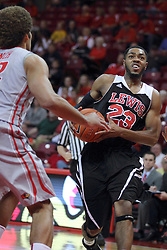 10 November 2014:  Julian Lewis heads for the hoop with Reggie Lynch in his way during an exhibition men's basketball game between Lewis University Flyers and the Illinois State Redbirds at Redbird Arena, Normal IL