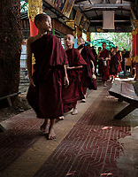 YANGON, MYANMAR - CIRCA DECEMBER 2017: Monks on a temple close to Yangon.