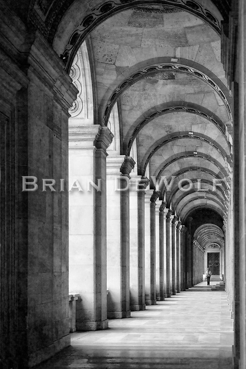 Repeating patterns accent the depth of the long arched prominade adjacent to the Cour Napoleon of the Louvre.