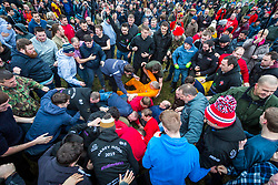 """© Licensed to London News Pictures. 05/01/2019. Haxey UK. The """"sway"""" begins at the start of the Haxey Hood game in the village of Haxey today. The traditional game of Haxey Hood is taking place today in Haxey despite only one of the four pubs usually involved taking part. The Kings Arms, Duke William & The Loco pubs will all be closed today leaving just the Westwoodside's Carpenters Arms taking part. The traditional game, which dates from 1359, sees drinkers from pubs in the two villages attempt to win the Hood – a tube of leather – by 'swaying' it to their favoured watering hole in a muddy and bruising encounter which can take hours. Normally, victory is declared when the landlord of the winning pub takes delivery of the Hood on the pub doorstep but in the event of a Haxey win this year, a win will be claimed when the Hood reaches a pre-detemined point near the Kings Arms. Photo credit: Andrew McCaren/LNP"""