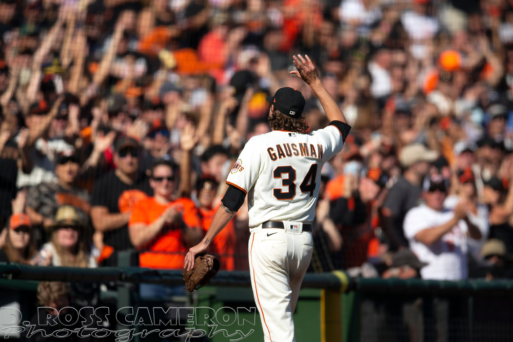 San Francisco Giants starting pitcher Kevin Gausman (34) acknowledges the cheers of the crowd as he's removed for a reliever at the start of the eighth inning of a baseball game, Saturday, Oct. 2, 2021, in San Francisco. (AP Photo/D. Ross Cameron)