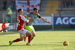 Walsall's Zeli Ismail battles for the ball with Fleetwood Town's Ashley Hunter