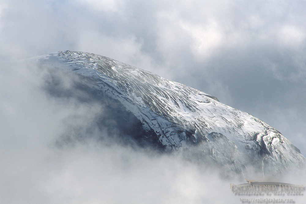 Fall storm clouds shroud the snow covered shoulder of Half Dome, Yosemite Valley, Yosemite National Park, California Fall storm clouds parting over the top of Half Dome, above Yosemite Valley, Yosemite National Park, CALIFORNIA