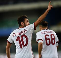 VERONA, Oct. 26, 2017  AC Milan's Hakan Calhanoglu (L) celebrates after scoring during a Serie A soccer match between AC Milan and Chievo in Verona, Italy, Oct. 25, 2017. AC Milan won 4-1. (Credit Image: © Alberto Lingria/Xinhua via ZUMA Wire)