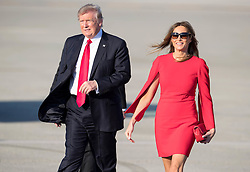 February 3, 2017 - West Palm Beach, Florida, U.S. - President DONALD J. TRUMP with his wife, Melania, walk across tarmac to greet friends after arriving at Palm Beach International Airport in West Palm Beach. Trump will be spending the weekend at his Mar-a-Lago estate in Palm Beach. (Credit Image: © Allen Eyestone/The Palm Beach Post via ZUMA Wire)