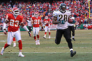Jacksonville Jaguars running back Fred Taylor (28) rushes into the end zone past Kansas City defensive back Patrick Surtain (23) in the first half, at Arrowhead Stadium in Kansas City, Missouri, December 31, 2006.  The Chiefs beat the Jaguars 35-30.<br />