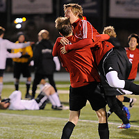 Mountain View's Curtis Markle (20) jumps into the arms of Mike McClean (16) to celebrate their win over Summit to advance to the State Finals this weekend.