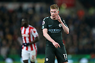 Kevin De Bruyne of Manchester City looks on. Premier league match, Stoke City v Manchester City at the Bet365 Stadium in Stoke on Trent, Staffs on Monday 12th March 2018.<br /> pic by Andrew Orchard, Andrew Orchard sports photography.