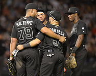 CHICAGO - AUGUST 23:  Jose Abreu #79 and Yolmer Sanchez #5 of the Chicago White Sox are arm in arm during a pitching change against the Texas Rangers during Players Weekend on August 23, 2019 at Guaranteed Rate Field in Chicago, Illinois.  (Photo by Ron Vesely)  Subject:   Jose Abreu; Yolmer Sanchez