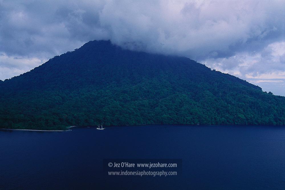 Phinisi Schooner at Mount Rakata Island, Krakatau Nature Reserve, Sunda Straits, Lampung, Sumatra, near Banten, West Java, Indonesia.