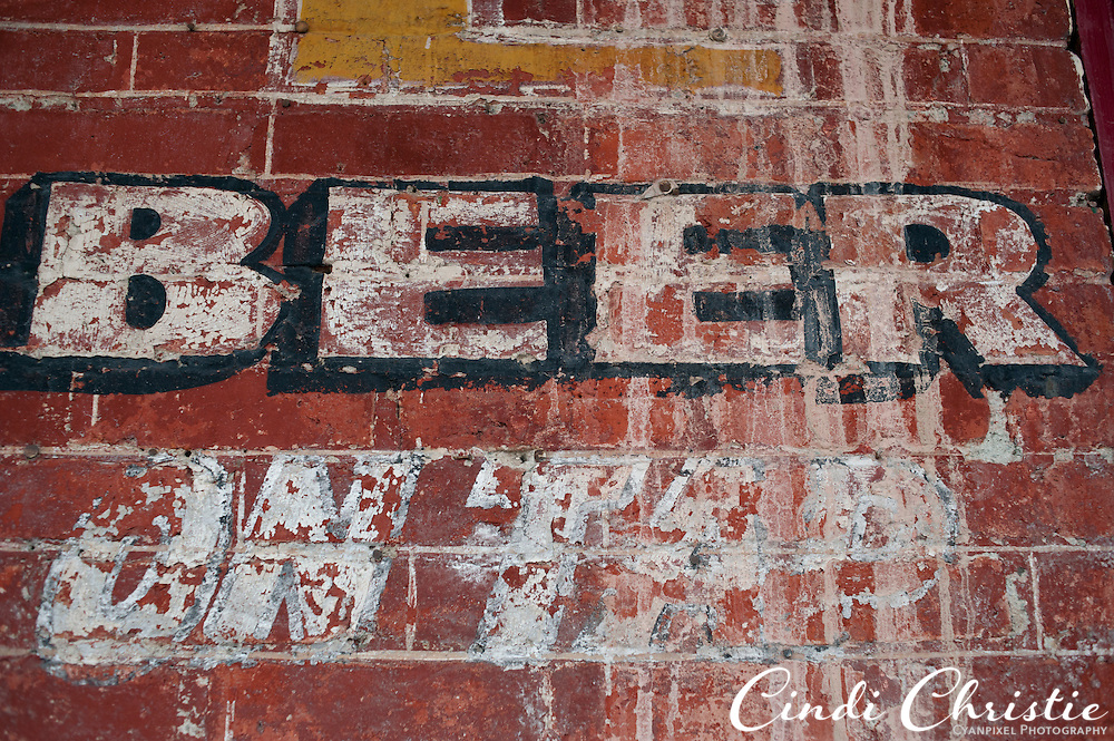 An aged sign for beer on tap remains on a brick wall in Virginia City, Nev., on Saturday, April 23, 2011.The Comstock Lode turned Virginia City and surrounding mining communities into boomtowns as people sought their fortunes in gold and silver. The main street through town has many museums, saloons and businesses that keep the area's mining past alive. (© 2011 Cindi Christie/Cyanpixel® Photography)