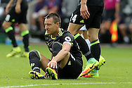 John Terry of Chelsea holds his leg after taking a knock. Premier league match, Swansea city v Chelsea at the Liberty Stadium in Swansea, South Wales on Sunday 11th Sept 2016.<br /> pic by  Andrew Orchard, Andrew Orchard sports photography.
