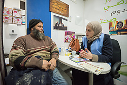 26 February 2020, Abu Dis, Palestine: 43-year-old construction worker Ziad Halabeye from Abu Dis receives nutritional advice from dietitian Samah Khatib as he visits the Augusta Victoria Hospital's Mobile Diabetes Clinic. In an effort to make Diabetes services more accessible to people in the West Bank, the Augusta Victoria Hospital offers a Mobile Diabetes Clinic, which moves around to various locations in the West Bank, offering screening and routine testing for Diabietes and the symptoms it causes.