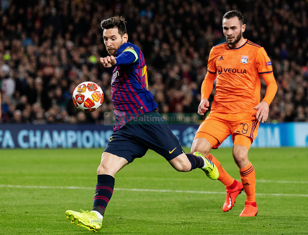 BARCELONA, March 14, 2019  Barcelona's Lionel Messi (L) shoots during the UEFA Champions League match between Spanish team FC Barcelona and French team Lyon in Barcelona, Spain, on March 13, 2019. Barcelona won 5-1 and advanced to the quarterfinals. (Credit Image: © Joan Gosa/Xinhua via ZUMA Wire)