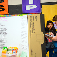 """112113  Adron Gardner/Independent<br /> <br /> Katarina Chamberlin, left, awaits questions from science fair judge Kelly Thomas-Coyle for the project """"Is your mouth dirtier than your cat or dog?"""" at the Red Rock Elementary science fair in Gallup Thursday."""